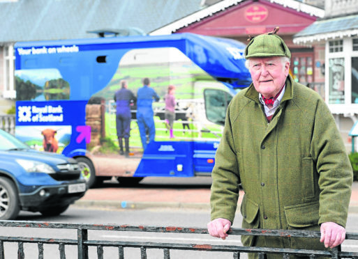 Joe Taylor, Kingussie Community Council Chairman outside the Royal Bank of Scotland van in the town which is having its stopping times reduced as part of the bank closures programme.