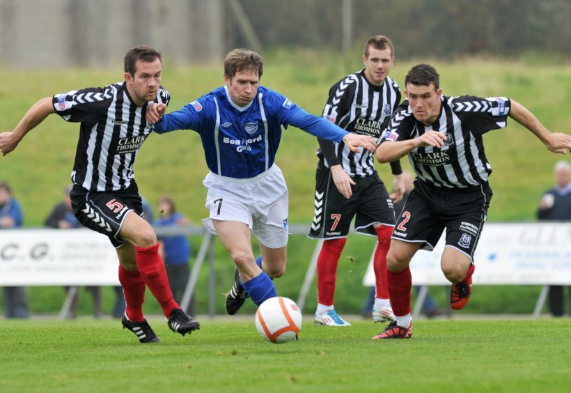 Wyness in the blue of Peterhead against Elgin.