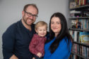 Andy Irvine and Cheryl Mainland with their son, Miller