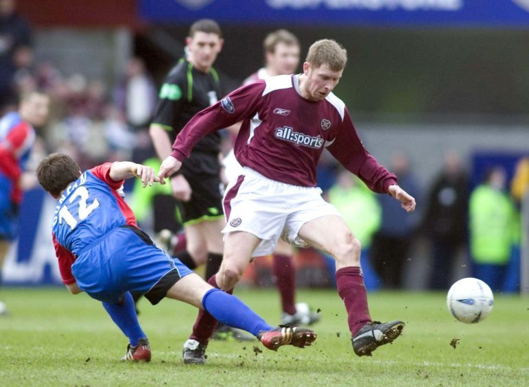 Wyness takes on ICT in a Hearts jersey.
