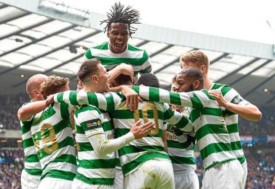 Moussa Dembele celebrates with his teammates