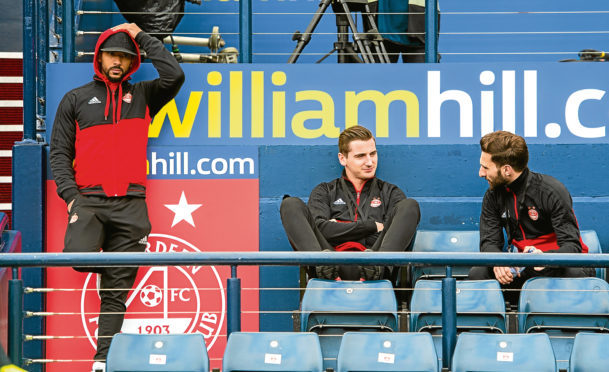 Graeme Shinnie watched last week's Scottish Cup semi-final defeat in the stands along with Shay Logan and Kenny McLean.