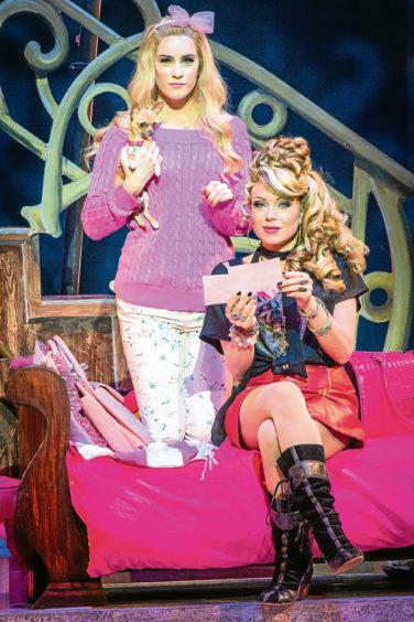 Lucie Jones as Elle, holding Bruisey as Bruiser Woods, and Rita Simons, seated, as Paulette Bonafonte