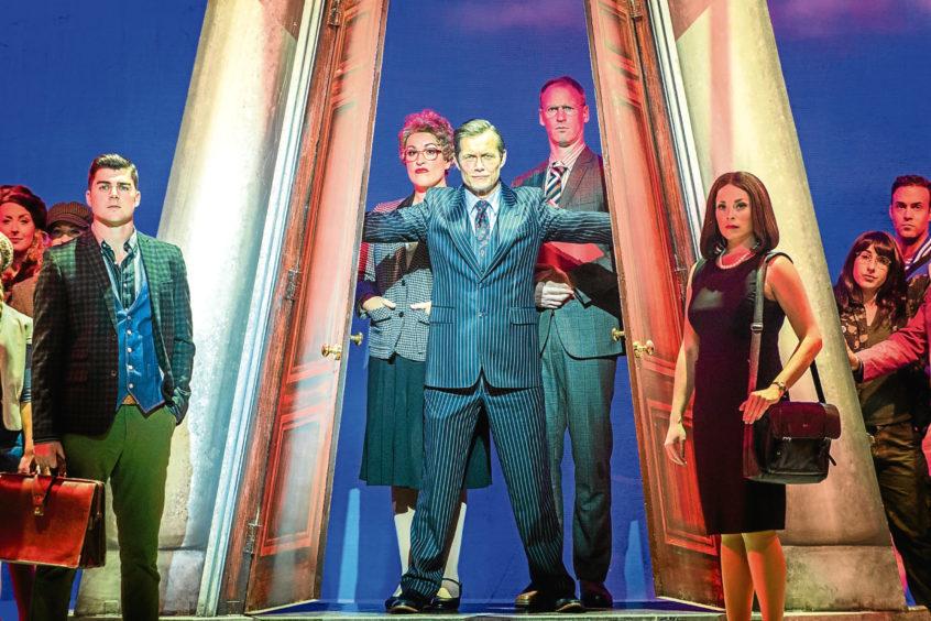 Bill Ward as Professor Callahan, centre, with, from left, Liam Doyle (Warner Huntington III) and Laura Harrison (Vivienne Kensington)