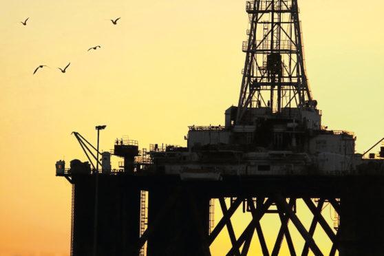 Silhouette of an oil rig       sun rising setting generic black gold offshore birds platform