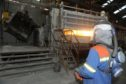 Fort William Aluminium Smelter. Casting Operator Michael Hartley at work pouring molten aluminium in the factory. Picture by Sandy McCook.