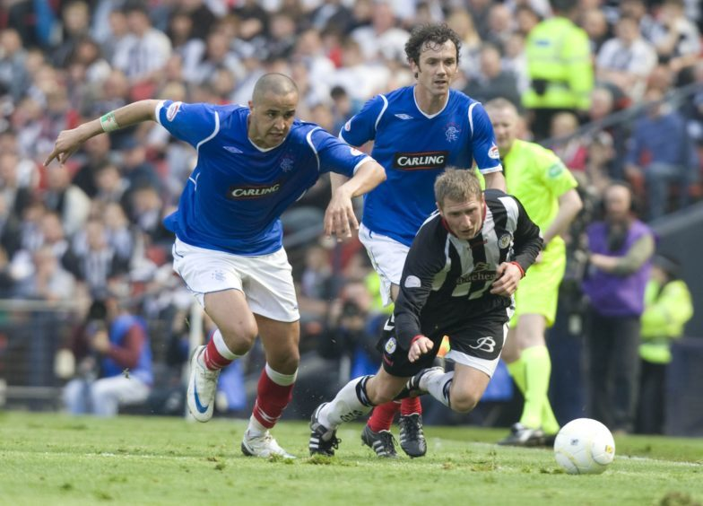 Rangers duo Madjid Bougherra (left) and Christian Dailly crowd out Dennis Wyness in 2009.