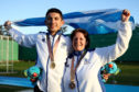 Men's Double Trap Finals gold medalist David McMath of Scotland (L) and Women's Double Trap Finals bronze medalist Linda Pearson of Scotland pose during the medal ceremony on day seven of the Gold Coast 2018 Commonwealth Games at Belmont Shooting Centre.