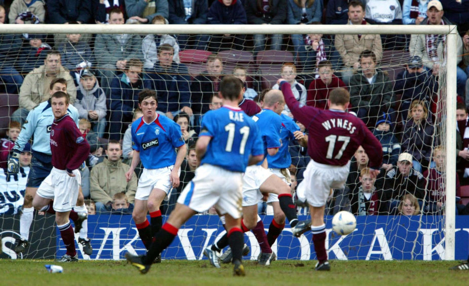 Dennis Wyness (far right) scores the equalising goal against Rangers in March 2004.