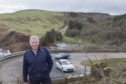 Helmsdale based consulting civil engineer Colin Mackenzie with Berriedale Braes in the background.