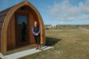 Owner Anne MacLellan beside a glamping pod at the campsite, another two pods are part of the expansion plans