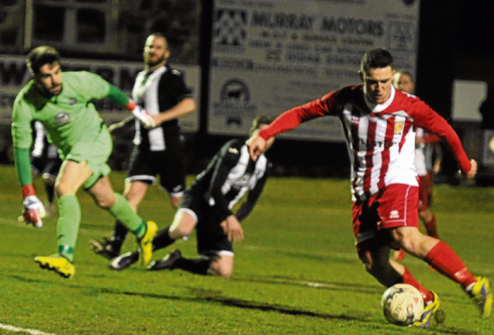 Scott Barbour is on the mark to make it 1-0 for Formartine United against Fraserburgh at Bellsea Park last night.
