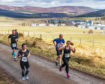 Runners reach the top of the incline and give a thumbs up during the Glenlivet 10K yesterday.