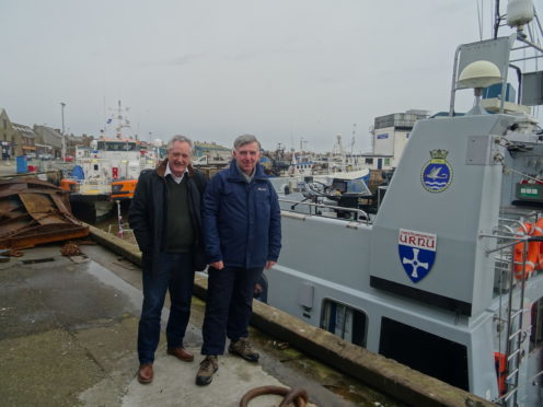 Heldon and Laich councillor John Cowe and Moray Council's Armed Forces Champion, Donald Gatt, ready to board HMS Example at Peterhead Harbour