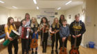 HebCelt director Caroline Maclennan (back, left) and Kerry Macphee with some young feis musicians.