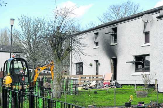 The scene of Munro Crescent house fire in Milton, Easter Ross.
