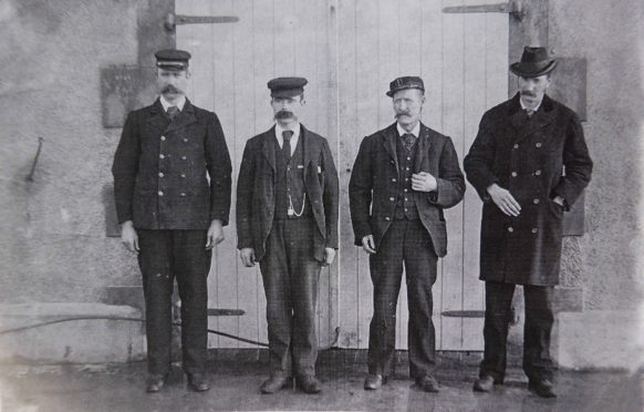 Last photograph of the three keepers on Eilean Mor from left to right, Marshall, Ducat and MacArthur with Muirhead on the right