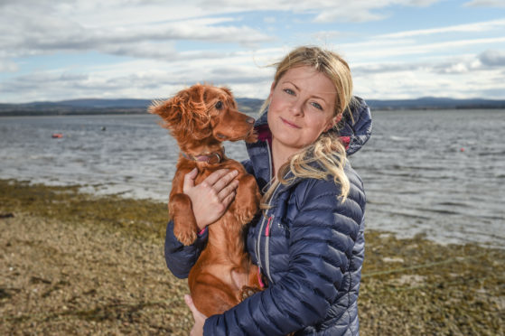 Luna the dog and her owner Sarah Blackburn at the location in Findhorn, Moray, where Luna the dog required a rescue from the coastguard.