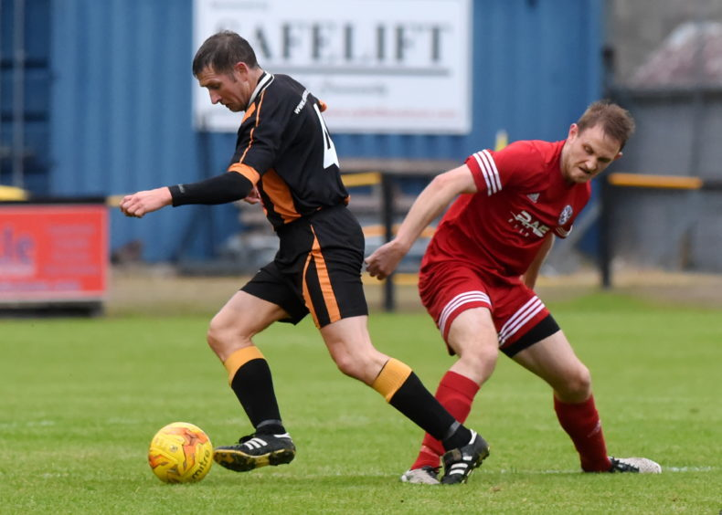Wyness (left) playing for Huntly against Brora Rangers. Picture by Kenny Elrick