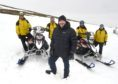 The Cairngorm Mountain Rescue Team  have been presented with two new snow scooters by Andy Clark and Laura Hepburn of Osprey3