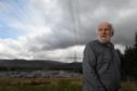 Steven Lanning of Auchterawe who is concerned along with neighbours over the proposed extension to the Fort Augustus sub station and its effect on house values and health. Picture by Sandy McCook.
