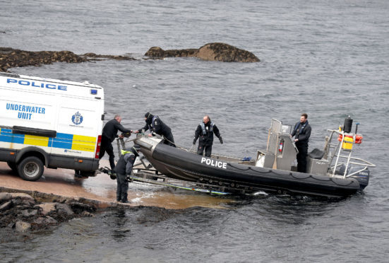 This underwater unit boat enters the water on Loch Fyne in Tarbert, Scotland, as Police Scotland continue their operation to recover the wreck of capsized fishing boat Nancy Glen after it sank on January 18 and resulted in the loss of fishermen Duncan MacDougall and Przemek Krawczyk. PRESS ASSOCIATION Photo. Picture date: Wednesday April 11, 2018. See PA story RESCUE Fisherman. Photo credit should read: Andrew Milligan/PA Wire
