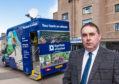 Heldon and Laich councillor James Allan outside the mobile bank in Lossiemouth.