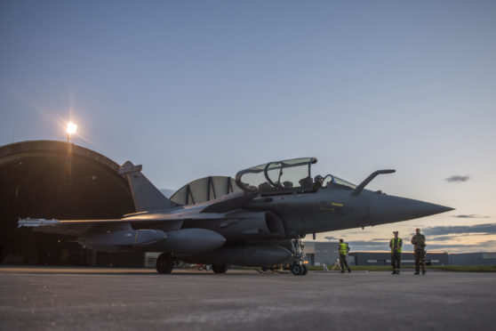 A Dassault Rafale fighter aircraft is prepared for airstrikes in Syria at Saint Dizier airbase, eastern France. A Syrian military statement says the U.S., Britain and France fired 110 missiles during a joint attack on targets in Damascus and outside.