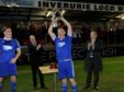 Cove captain Eric Watson lifts the trophy. Picture by Colin Rennie.