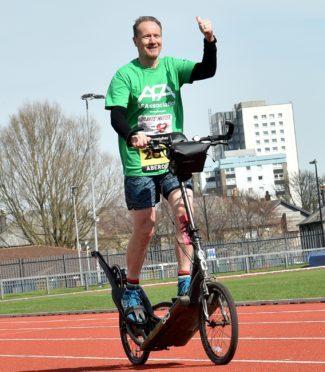 Ian Thom gets on his bike.