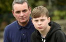 Drew Ramsay, 13, Alford, lost his drone when Maplin went into administration. In the picture are stepdad, Quentin Murray and Drew Ramsay.   Picture by Jim Irvine  4-4-18