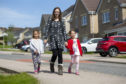 """Pictured: Amy Taylor, with """"Miracle Twins"""" Gaia & Luna (red top) Taylor (age 5).  Photo: Ross Johnston/Newsline Media."""