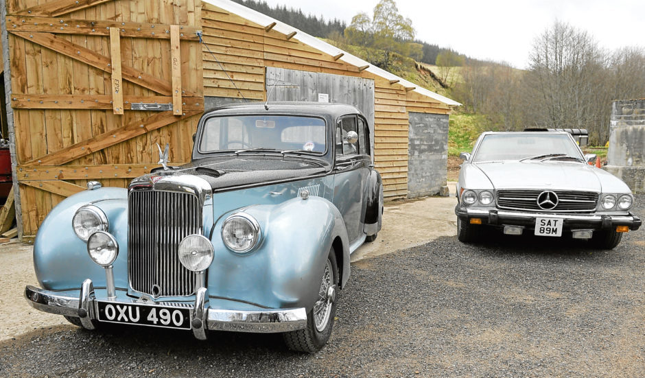 A snapshot of his Alvis and Mercedes.