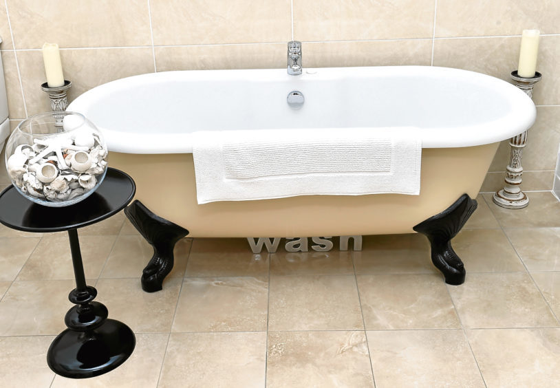 The free-standing roll top bath