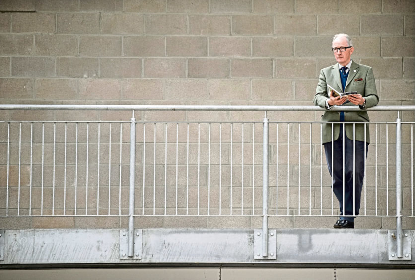 United Auctions stalwart David Leggat looks on at proceedings from the gallery