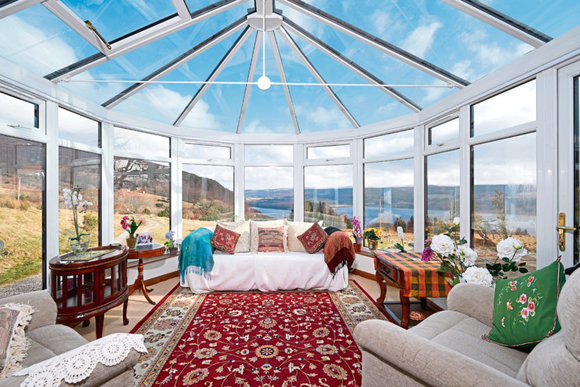 The conservatory provides spectacular views over iconic Loch Ness