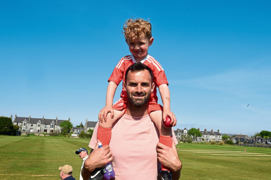 Aberdeen Fc goalkeeper, Joe Lewis with his son, Lenny at Mannofield cricket, Aberdeen.   Picture by Jim Irvine  26-5-18