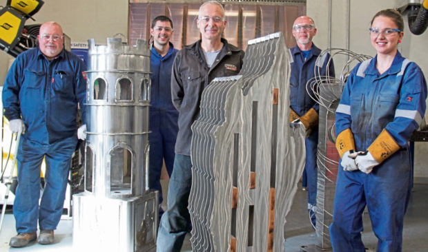 Jonathan Tyndall, Samuel Domingo, Brian McWilliam and Krista Kuke with the sculptures alongside lecturer Martin Summers