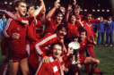 The Gothenburg Greats celebrate with the trophy on a night in which victory over Real Madrid would make them immortal