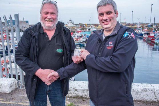 Jesper Olsen and lifeboat coxswain John Stephen