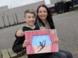 Dyce Academy pupil Josh McPherson's artwork is going to be showcased in the Scottish Parliament this June. He is pictured with his mum Catherine McPherson. Picture by Kath Flannery.