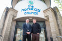 Conservative councillors Marc Macrae and Tim Eagle have threatened to quit the council's administration.