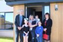 The Cruikshank family has moved into one of the new homes in Elgin. Pictured: council leader George Alexander, Tiegan Cruickshank, Lyndsey Cruickshank, Mikey Cruickshank, Katie Cruickshank, communities committee chairwoman Lorna Creswell.