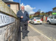 Elgin South Councillor, Mr John Divers on Moss Street in Elgin