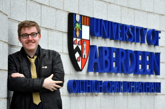 Frederic Bayer, President of the Celtic Society, at Aberdeen University, at the Regent Walk entrance to the university where the sign is by-lingual English and Gaelic.      Picture by Kami Thomson.