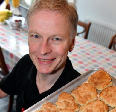 Judge Martin Gillespie with a tray of butteries