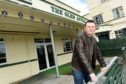 Craig McCormick with the former Glen Affric Bar in Cannich which he hopes to demolish and replace a new brewery.