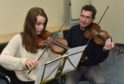 Ellie Wakerell receives instruction from guest tutor Charlie McKerron at the Fraserburgh event