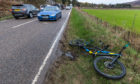 Police and ambulance teams were called to the scene of the incident on the A947 where a cyclist had been injured.