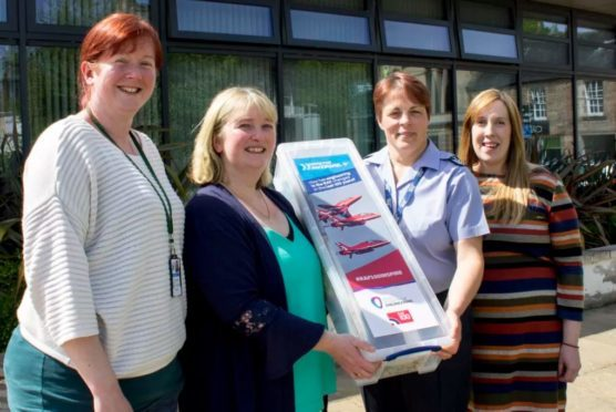 Carly Fearon from Burghead Primary, Veronica Nicol from Botriphnie Primary, RAF Lossiemouth's chief technician Heidi Blakely, and Flight Lieutenant Fiona Padbury.